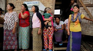 Women stand as Myanmar State Counselor