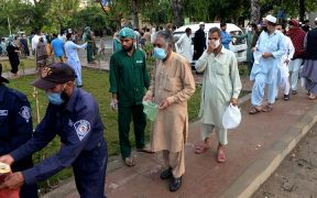Citizens queue to get tested for covid-19 in the capital Islamabad