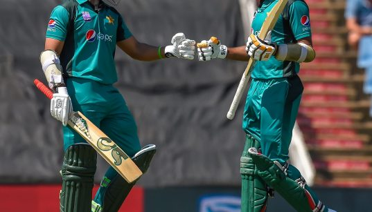 Babar and Imam bumping fists